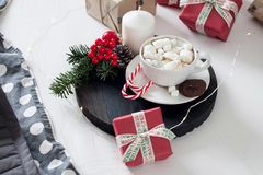 Christmas Breakfast in bed with a Cup of Coffee gift boxes, garlands and Christmas composition. stock image