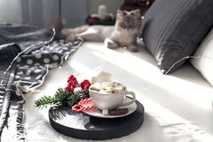 Christmas Breakfast in bed with a Cup of Coffee gift boxes, garlands and Christmas composition. royalty free stock photo