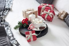 Christmas Breakfast in bed with a Cup of Coffee gift boxes, garlands and Christmas composition. royalty free stock image
