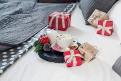 Christmas Breakfast in bed with a Cup of Coffee gift boxes, garlands and Christmas composition. stock photography