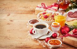 Christmas breakfast with gifts and decorations Royalty Free Stock Images
