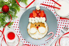 Free Christmas Breakfast Idea For Kids Santa Pancakes With Strawberries Royalty Free Stock Photography - 81408437
