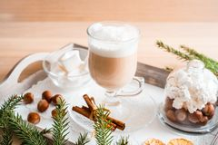 Christmas breakfast, pastry with winter spices and cappuccino, cinnamon and tangerine on a tray . There is a place for your inscri. Christmas breakfast, pastry royalty free stock photos