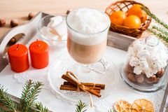 Christmas breakfast, pastry with winter spices and cappuccino, cinnamon and tangerine on a tray . There is a place for your inscri. Christmas breakfast, pastry stock photo