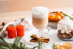 Christmas breakfast, pastry with winter spices and cappuccino, cinnamon and tangerine on a tray . There is a place for your inscri. Christmas breakfast, pastry royalty free stock image