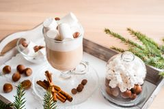 Christmas breakfast, pastry with winter spices and cappuccino, cinnamon and tangerine on a tray . There is a place for your inscri. Christmas breakfast, pastry stock photography