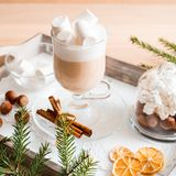 Christmas breakfast, pastry with winter spices and cappuccino, cinnamon and tangerine on a tray . There is a place for your inscri. Christmas breakfast, pastry royalty free stock photo
