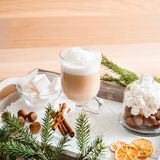 Christmas breakfast, pastry with winter spices and cappuccino, cinnamon and tangerine on a tray . There is a place for your inscri. Christmas breakfast, pastry royalty free stock images