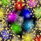 Christmas bright background with gold spangles and snowflakes Stock Image