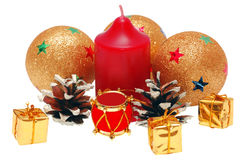 Christmas brilliant spheres and candle Stock Images