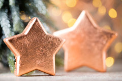 Christmas bronze decoration. Holiday decorations bronze on bokeh Stock Images