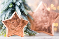 Christmas bronze decoration. Holiday decorations bronze on bokeh Royalty Free Stock Photos