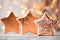 Christmas bronze decoration. Holiday decorations bronze on bokeh Royalty Free Stock Photography