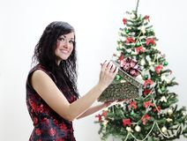 Christmas: brunette girl with gift Stock Images