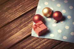 Christmas bubbles and gift box Stock Photos