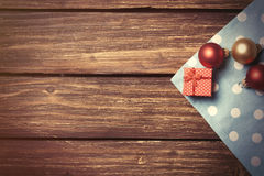 Christmas bubbles and gift box Royalty Free Stock Photography