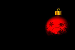 Christmas bulb. A red Christmas glitter ball with black backround stock photos