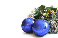 Christmas bulbs. Blue christmas bulbs decorated with mistletoe and gold ribbon Royalty Free Stock Photography