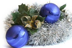 Christmas bulbs. Blue christmas bulbs decorated with mistletoe and gold ribbon Stock Photography