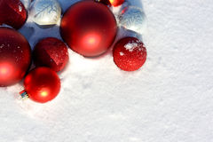Christmas Bulbs Frame in the Snow Stock Photo
