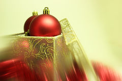 Christmas Bulbs in a Present Box. Red christmas bulbs in a gift box on a blurred background Stock Images