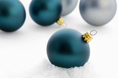Christmas Bulbs On Snow Stock Photos