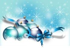 Christmas bulbs in snow Royalty Free Stock Photos