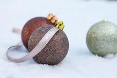 Christmas bulbs on snow Stock Image