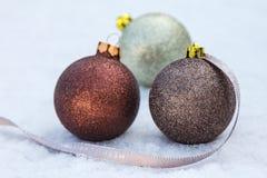 Christmas bulbs on snow Royalty Free Stock Images