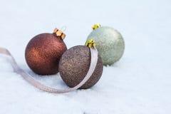 Christmas bulbs on snow Royalty Free Stock Photography