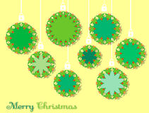 Christmas bulbs on a yellow background Royalty Free Stock Photos
