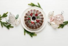 Christmas bundt cake with Xmas holiday decorations, top down view