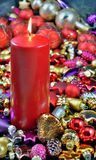 Christmas. Burning candle with Christmas decorations and ornaments on the Christmas tree Stock Photo