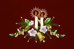 Christmas with burning candles and fir branches with flowers on vinous background Stock Images
