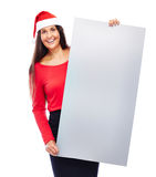 Christmas Business Woman holding Blank sign. Business woman with santa hat holding blank empty grey sign isolated on white Stock Photos
