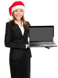 Christmas business woman holding computer laptop Royalty Free Stock Images