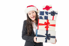 Christmas business woman with santa hat and gifts Stock Photo