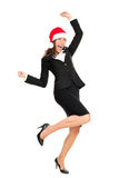 Christmas business woman wearing santa hat stock image