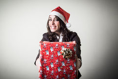 Christmas businesswoman with gift Stock Images