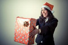 Christmas businesswoman with gift Royalty Free Stock Photos