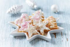 Christmas butter cookies with icing and sugar pearls. Bright wooden background. Close up stock photos