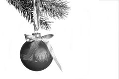 Christmas bw. A christmas bulb hanging from a tree stock image