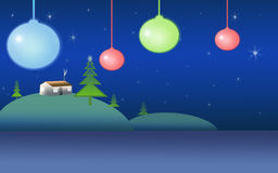 Christmas c. Christmas ornaments hanging in space with landscape in background Royalty Free Stock Images