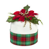 Christmas Cake. Covered in royal icing and decorated with holly, beads and ribbons Royalty Free Stock Image