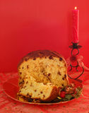 Christmas cake. Panettone italian christmas cake and candle Royalty Free Stock Photo