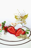 A Christmas Cake. With strawberries, sugar coated snowman isolated on white background Stock Image