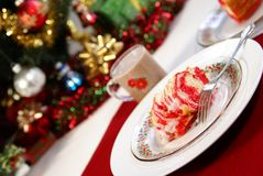 Christmas Cake. Festive red and yellow swirled Christmas cake on holiday dinnerware Royalty Free Stock Photos