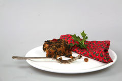 Christmas Cake. A piece of Christmas cake on a decorative place setting stock photo