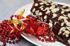 Christmas log. Christmas cake with the decoration and the gifts Royalty Free Stock Images