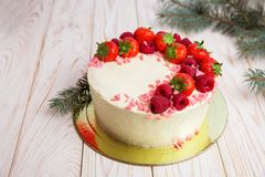 Christmas cake with berries. On wooden background Stock Photos